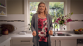 A woman performing a TV advertisement for Bupa Alarms